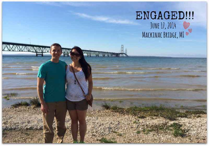 Newly engaged Christian singles stand at shores of Lake Michigan while smiling