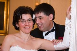 English Christian couple marry. Husband whispers in his wife's ear as she smiles