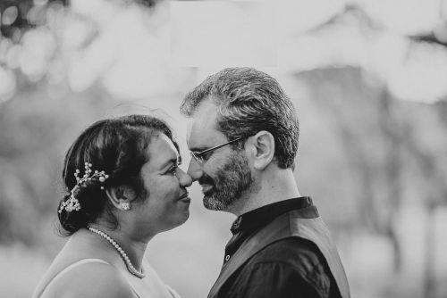 Tender marriage moment for couple getting ready to kiss