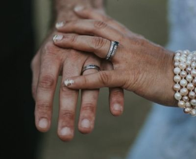 Wedding rings on display from proud newlyweds