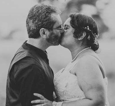Finally married couple kissing passionately at wedding