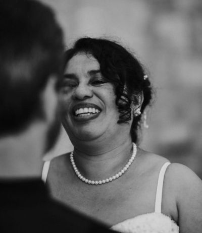 Laughter and joy from bride as she looks at her husband