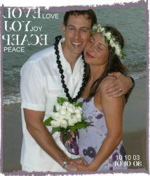 Hawaiian wedding for a happy Christian couple who hug on the beach