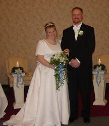 Single parent finds love at the altar and beams joyfully as he stands arm in arm with his new bride