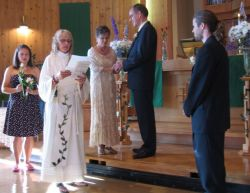 Christian couple receive their blessing at the altar