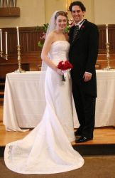 Proud Christians pose at the altar after marrying