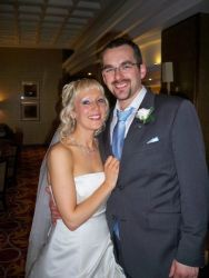 UK single Christians no more. A happy man and his new wife hug while smiling