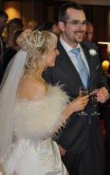 Christian wedding reception with groom in big smiles