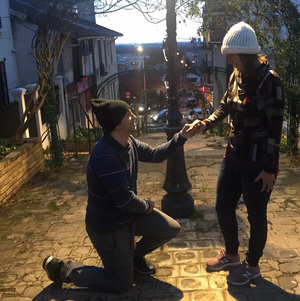 Belgian Christian single putting ring on fiancee in beautiful city