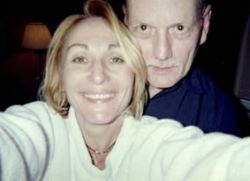 A man lets a pretty woman take a selfie of the two of them