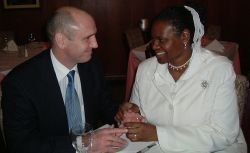 A woman smiles bashfully as a British Christian man smiles at her lovingly