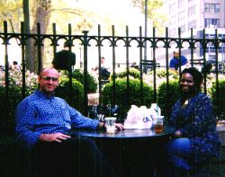 A couple enjoying a lunch date at an outdoor Cafe in New York