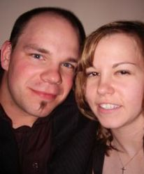 Two Christian singles from Alberta pose together cheek to cheek