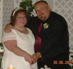 A couple overwhelmed with joy hug on their wedding day