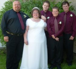 Divorced man poses with his sons and his new bride, smiles all around