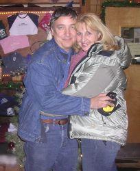 Alaskan Christian man hugs a California Christian single woman wearing a winter coat