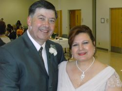 Texas Christian singles marry and are shown smiling at their reception