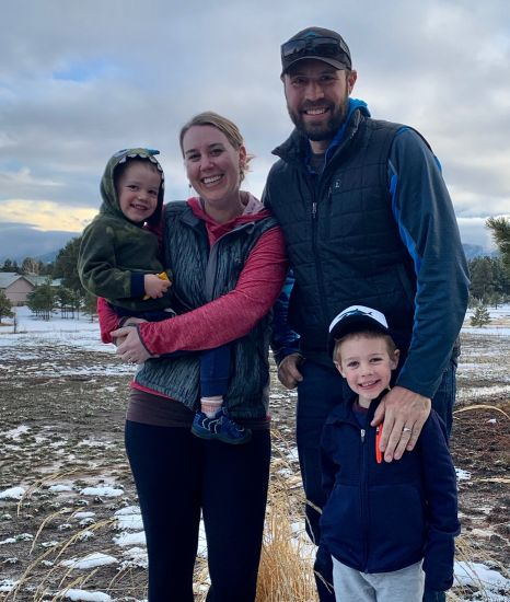 Christian family with 2 children stand outdoors in winter
