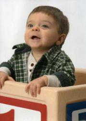 Toddler climbing out of box