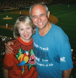 Former Christian singles look very happy and comfortable together at a baseball game