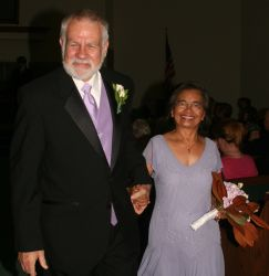 Senior interracial Christians are very much in love as they walk hand in hand