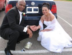 Christian single finds romance with Hawaiian and they hold hands while posing behind their wedding car