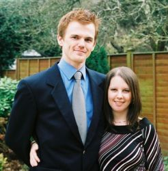 English Christian singles pose in the garden looking very happy together