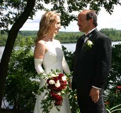 Newly married Christians from Quebec stare at each other lovingly near a river