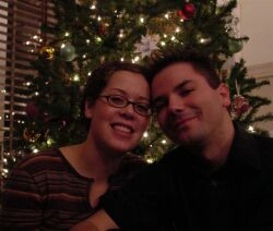 Ontario Christian singles in love in front of Christmas tree
