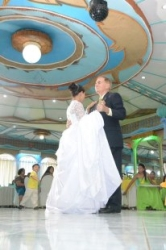 Newly married Interracial couple dance in a ballroom