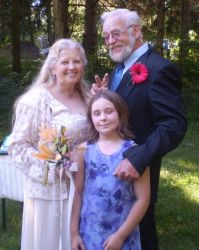 Widowed grandmother marries and stands next to her husband and granddaughter
