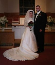 Smiling couple stand together in the church after marrying