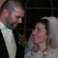 A bride laughs as she looks up at her new husband who only has eyes for her