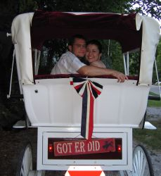 Christians ride in Wedding Carriage which says Get Er Did