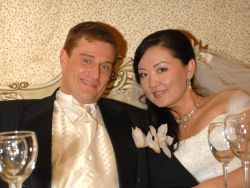 American marries a Christian woman from Kazakhstan who looks radiant at their reception table