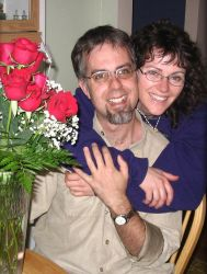 A single Christian woman hugs a happy man from behind