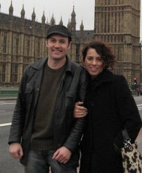 Christian couple expecting first child huddle together in London