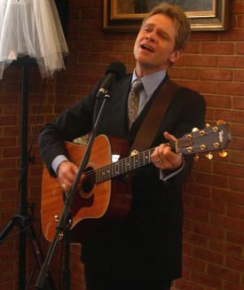 Christian performer sings and plays at a Christian wedding