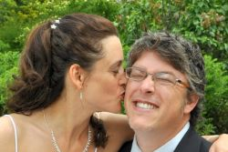 Wisconsin marriage made in heaven. A newly married woman kisses her overjoyed husband