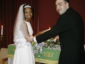 Newly married Christian couple won't let go of each other!