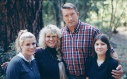 Blended Christian family on a hike in the forest