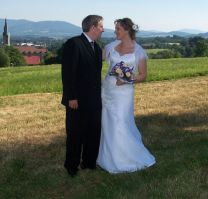 Beautiful Poland in the background as a married couple prepare to kiss