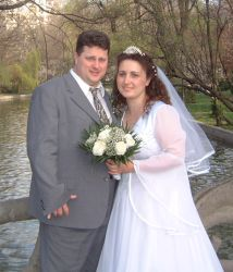 Beautiful water in background for these lucky newlyweds