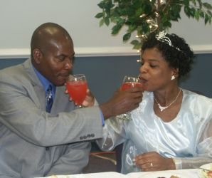 Newly weds try giving each other drinks and try not to laugh