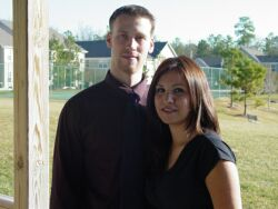 Cute Christian couple smile on the porch