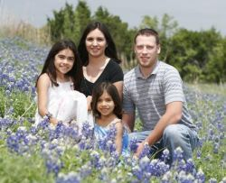 Gorgeous flowers and children surround Christian parents in spring