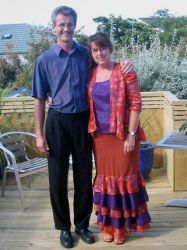 Former NZ Christian singles stand next to each other and embrace on a porch