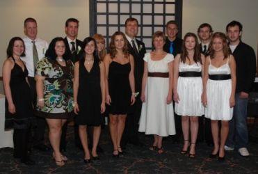 Blended Christian family pose at wedding