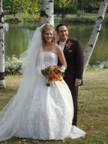 A very happy couple of former single Christians from Illinois pose together by a river after marrying