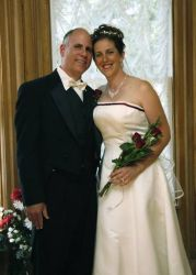 Perfectly matched Christian singles from Ontario laugh and stand cheek to cheek after marrying